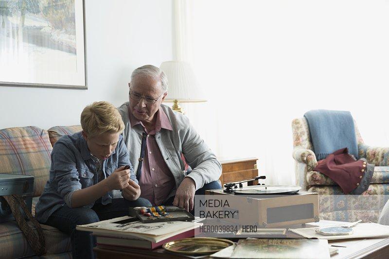 Grandfather showing grandson old war medals