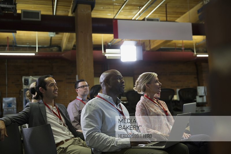 Business people in conference audience
