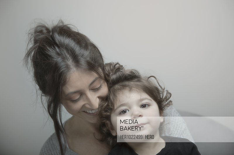 Portrait cute Latina toddler girl with mother