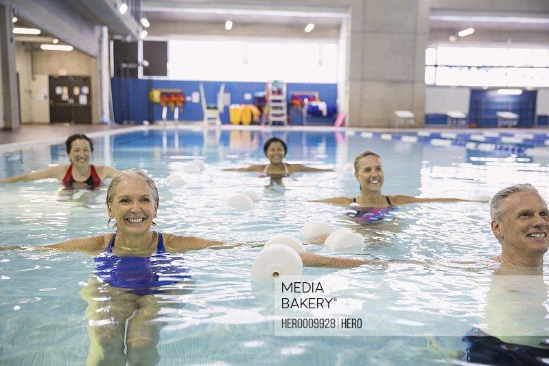 Water aerobics class at indoor swimming pool