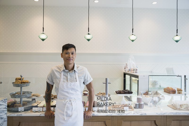 Portrait confident bakery business owner