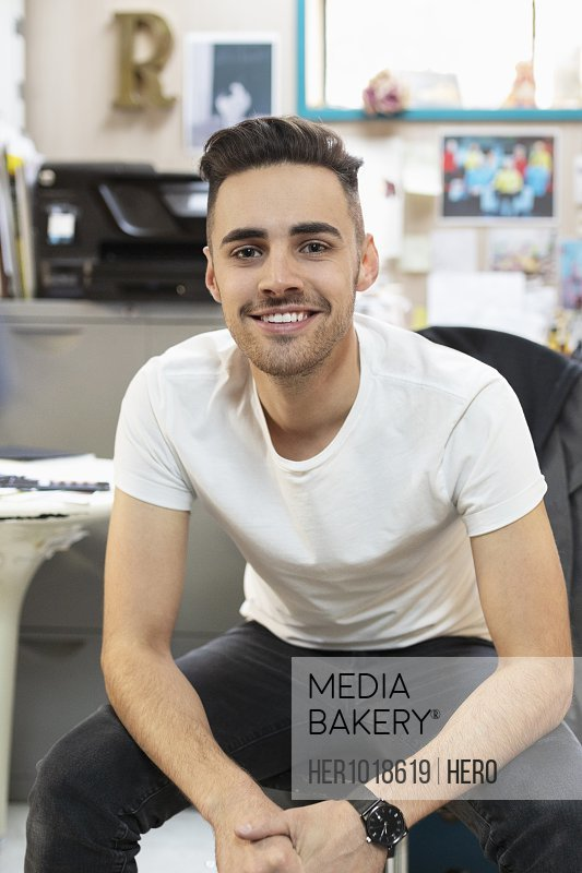 Portrait smiling, confident male business owner in office