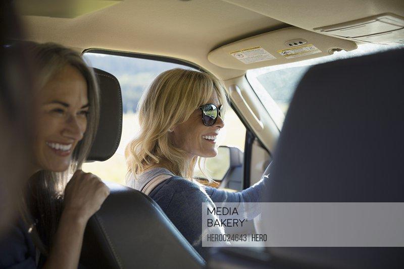 Smiling women driving in car