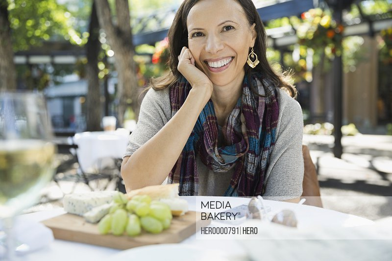 Woman sitting at outdoor restaurant