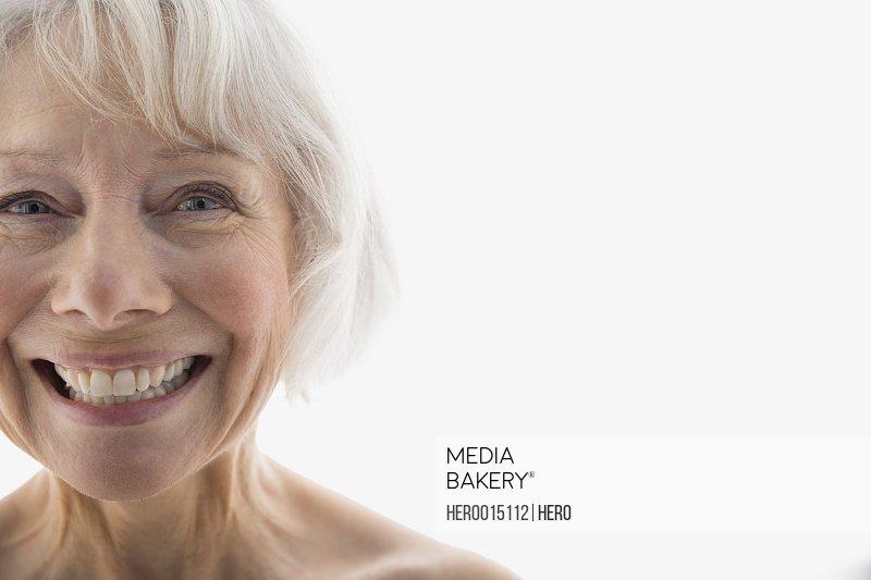 Close up portrait of enthusiastic senior woman