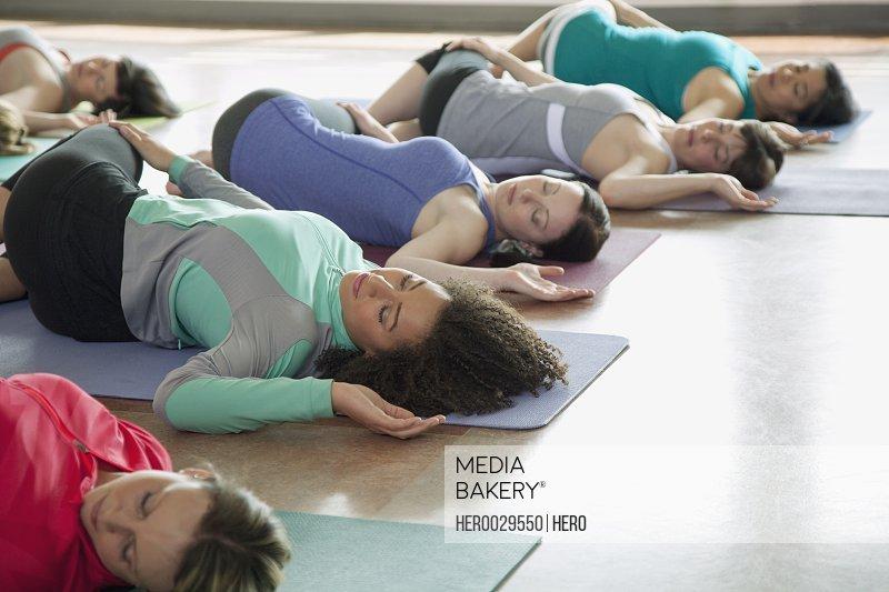 women stretching during yoga class