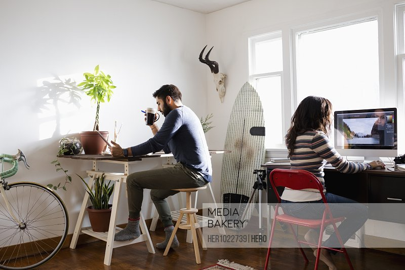 Creative freelance couple working in home office
