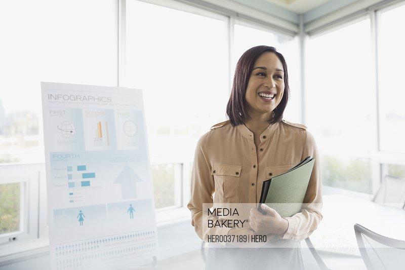 Businesswoman smiling in boardroom