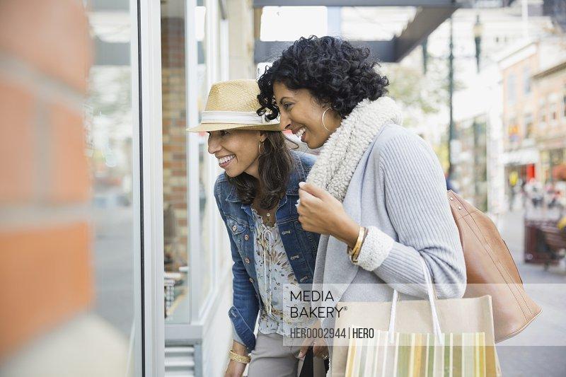 Female friends window shopping