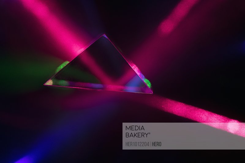 Creative, abstract multicolor laser refracting from triangle