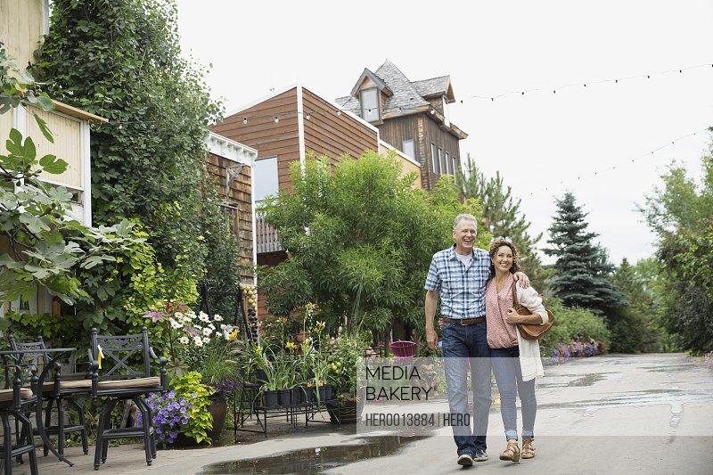 Smiling couple walking outside plant nursery