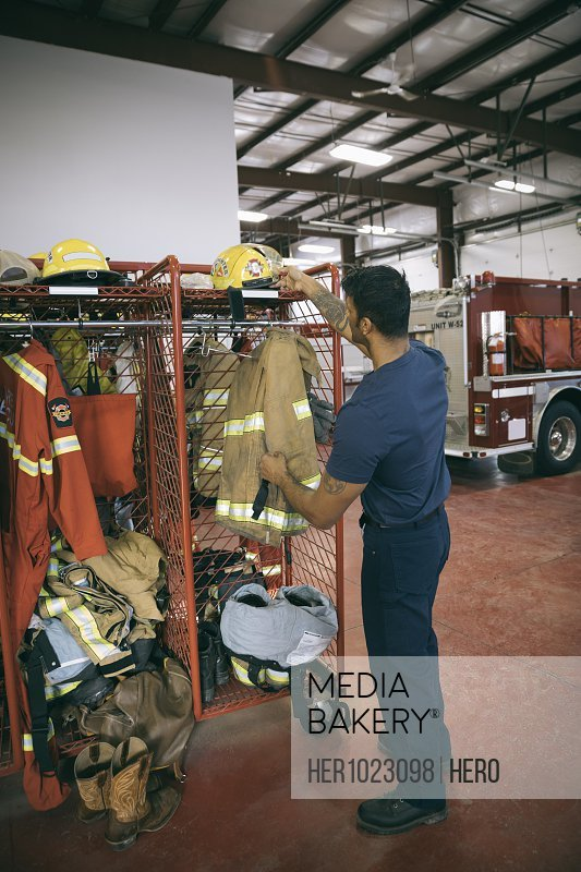 Firefighter checking equipment in fire station