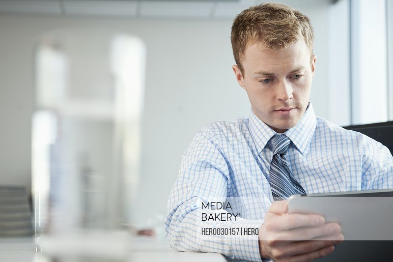 young business man on ipad