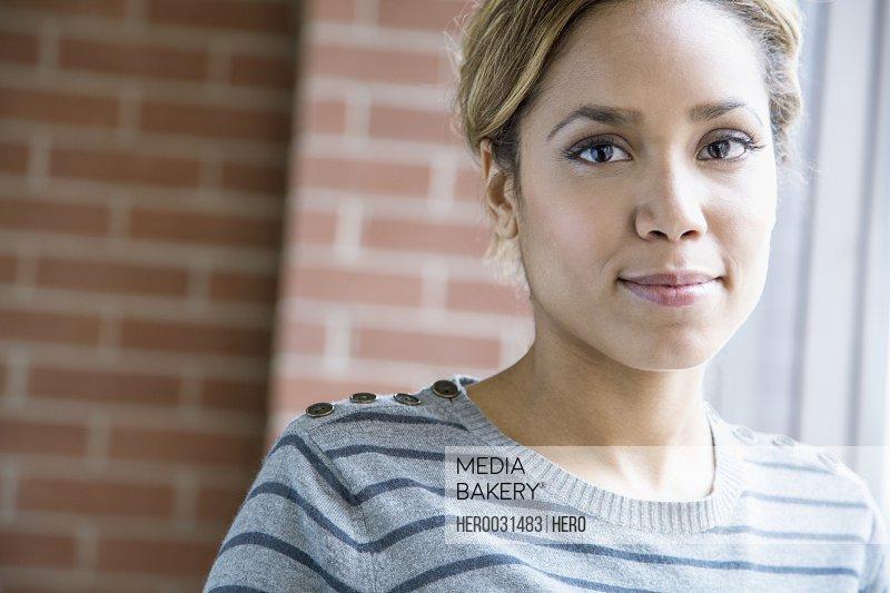 portrait of pretty african american woman in office