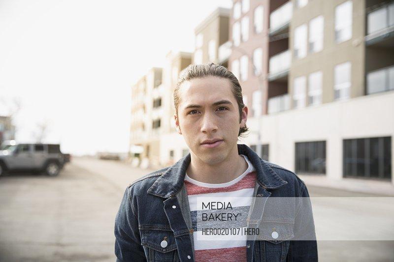 Portrait of serious man on urban street