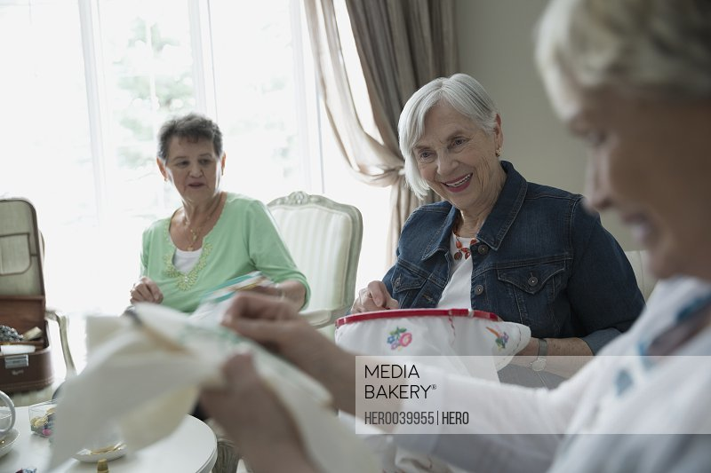 Senior women embroidering