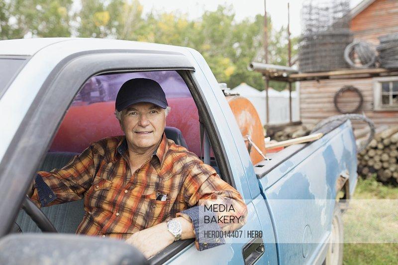 Portrait of confident farmer inside truck