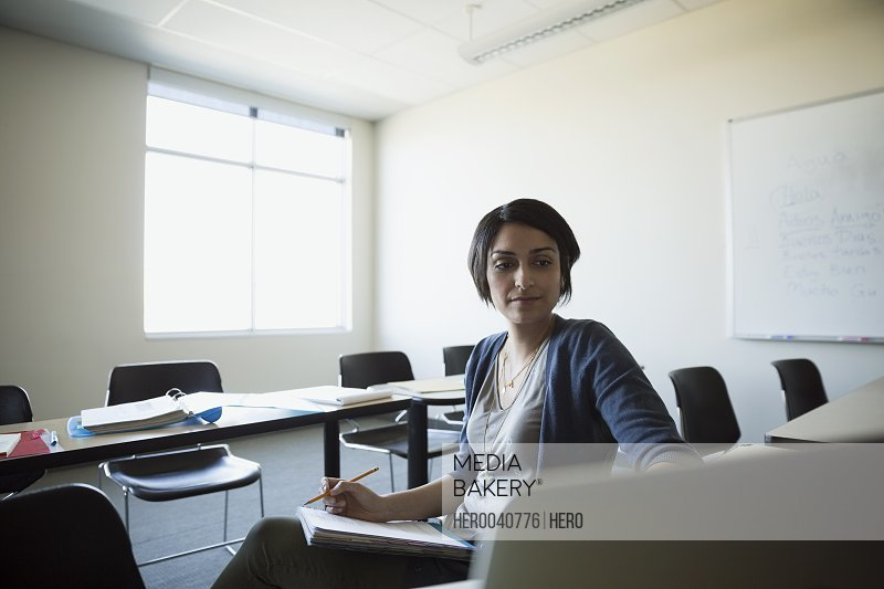 Adult education student studying in classroom