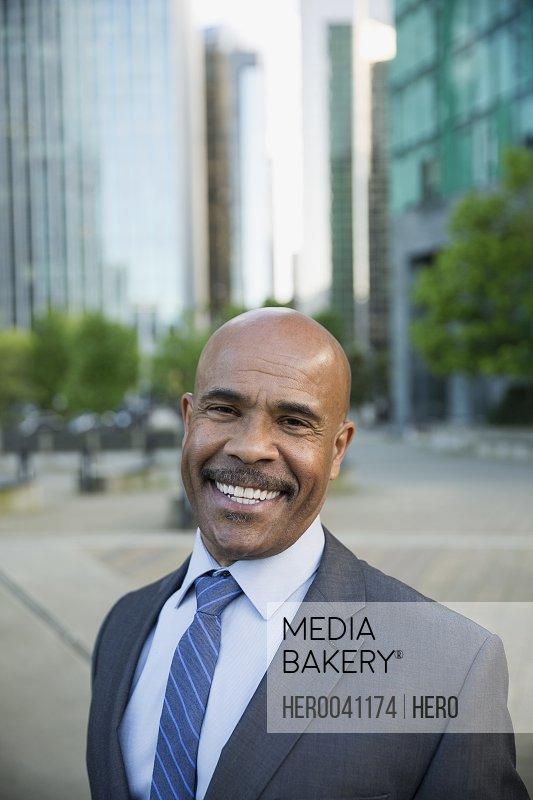 Portrait smiling businessman in city