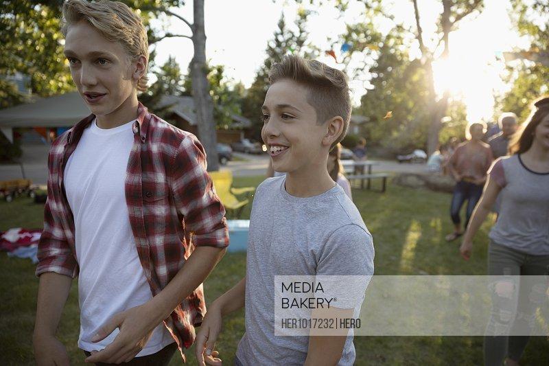 Boys at summer neighborhood block party in park