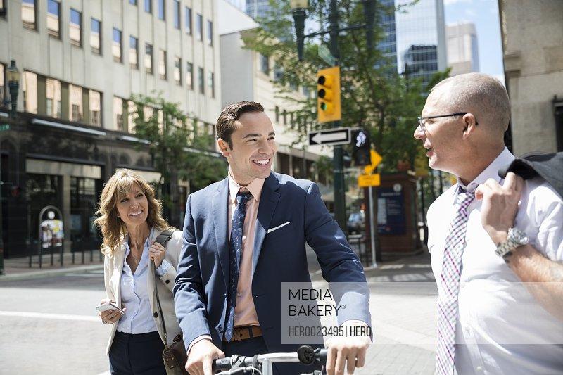Business people crossing city street