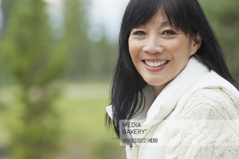 portrait of pretty middle-aged asian woman in a sweater