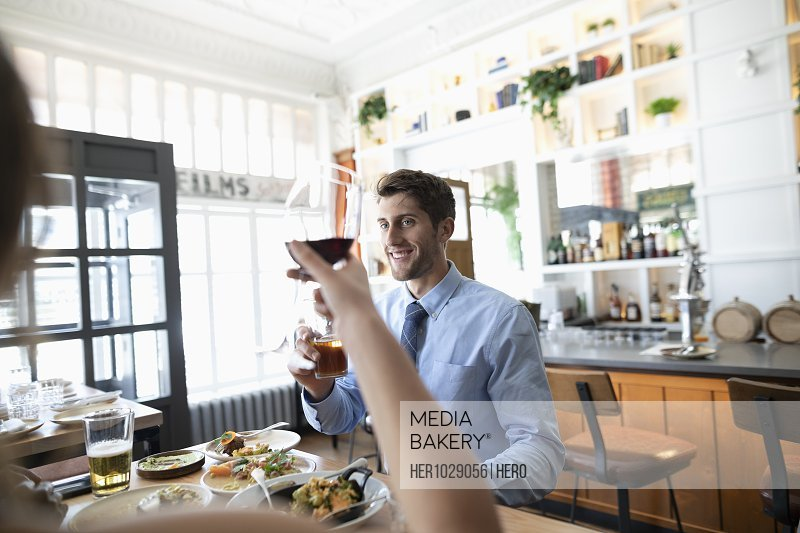 Businessman toasting glass of wine with colleague