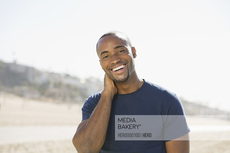 Portrait of smiling man on beach