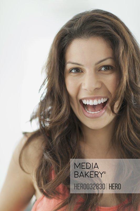 portrait of pretty latin american woman with big smile