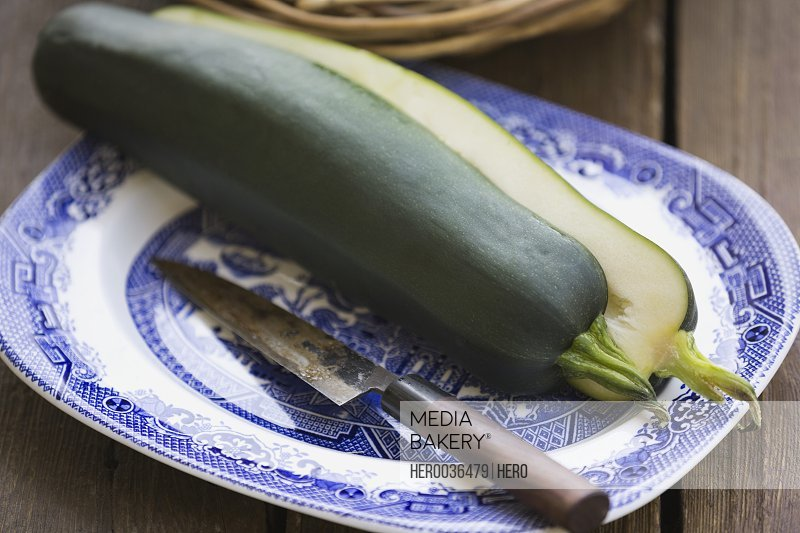 Zucchini sliced into two on plate