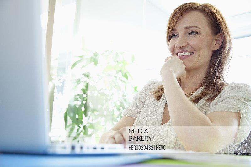 pretty businesswoman at desk