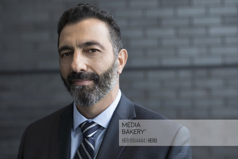 Close up portrait confident businessman with beard