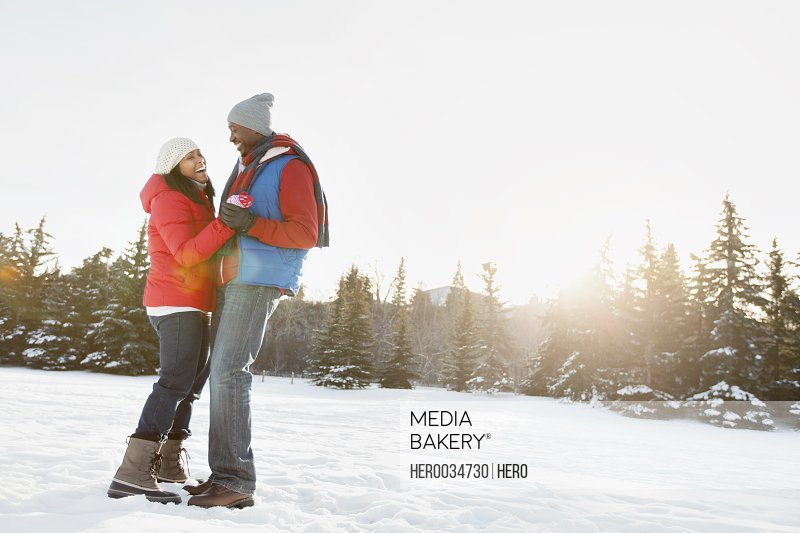 Couple dancing outdoors in winter