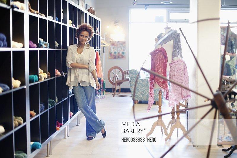 owner of yarn store posing