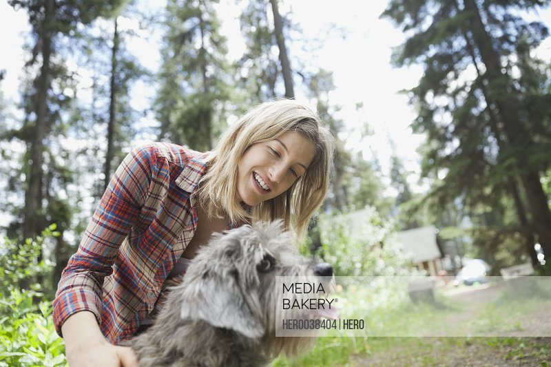 Woman petting dog outdoors