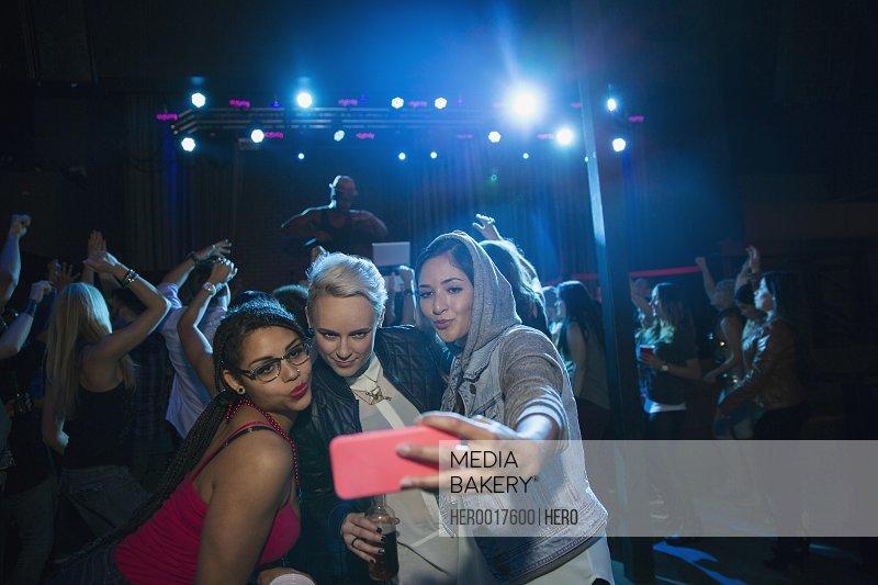 Women taking selfie in nightclub