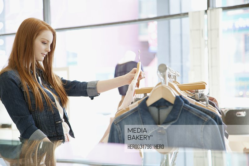 young woman shopping at trendy clothing store