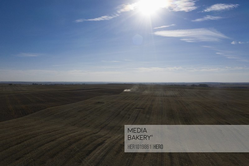 Sun shining over rural farmland landscape