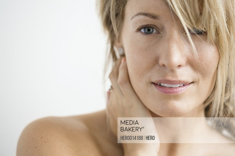 Close up of blonde woman with bare chest