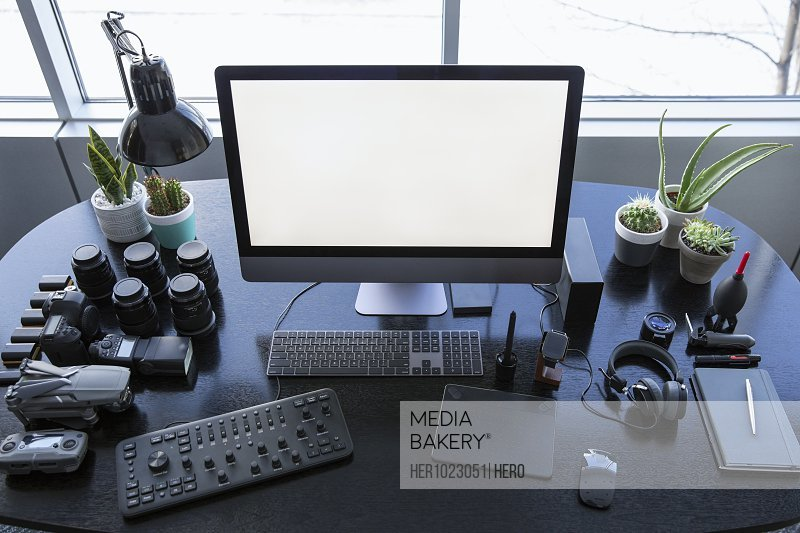 Photography and drone operator equipment on desk