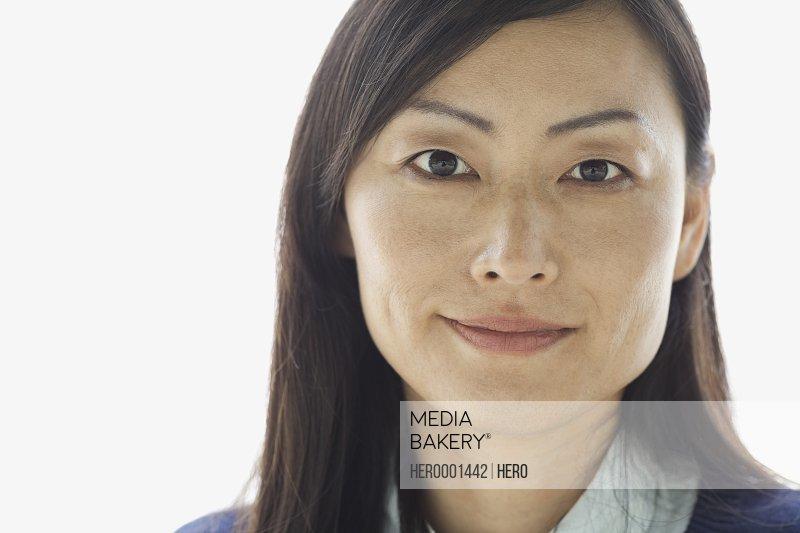Portrait of confident woman against white background