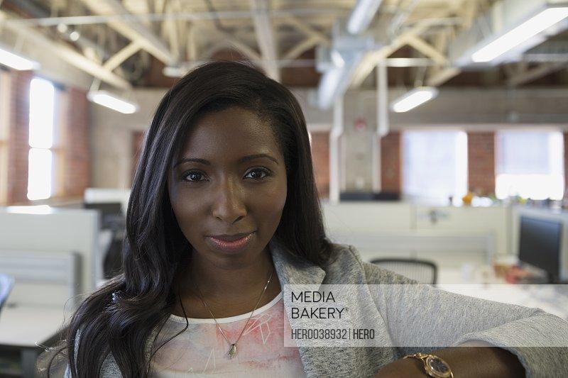 Close up portrait confident businesswoman in office