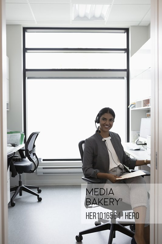 Portrait smiling, confident woman working in clinic office