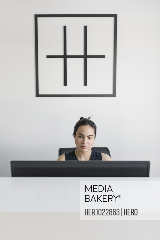 Female receptionist working at computer