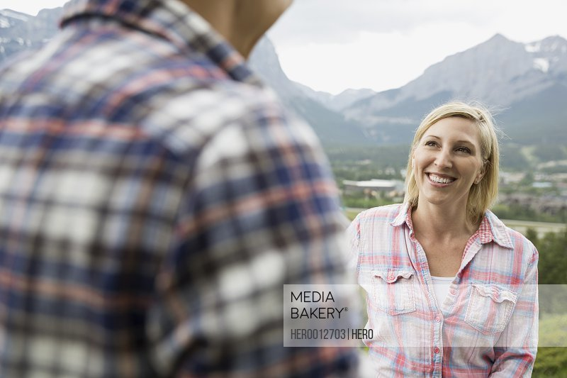 Couple talking on rural hillside