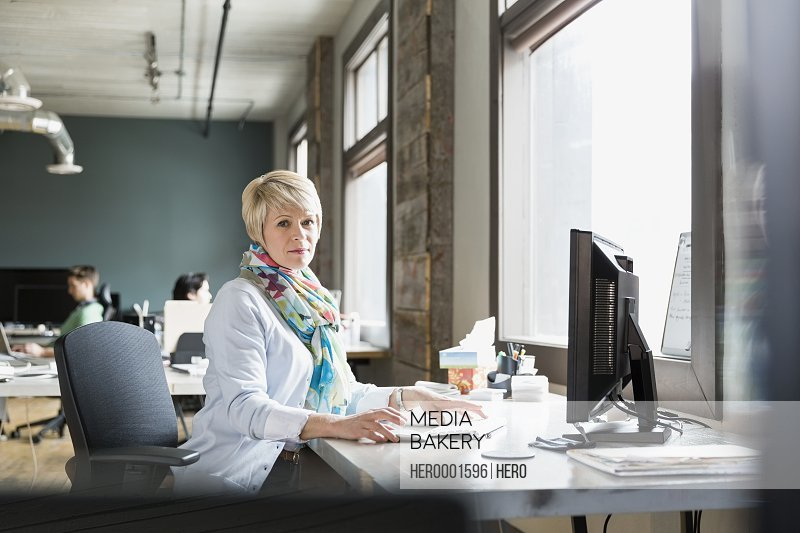 Portrait of female entrepreneur working in creative office space