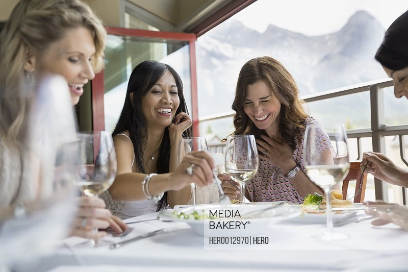 Women eating together in restaurant