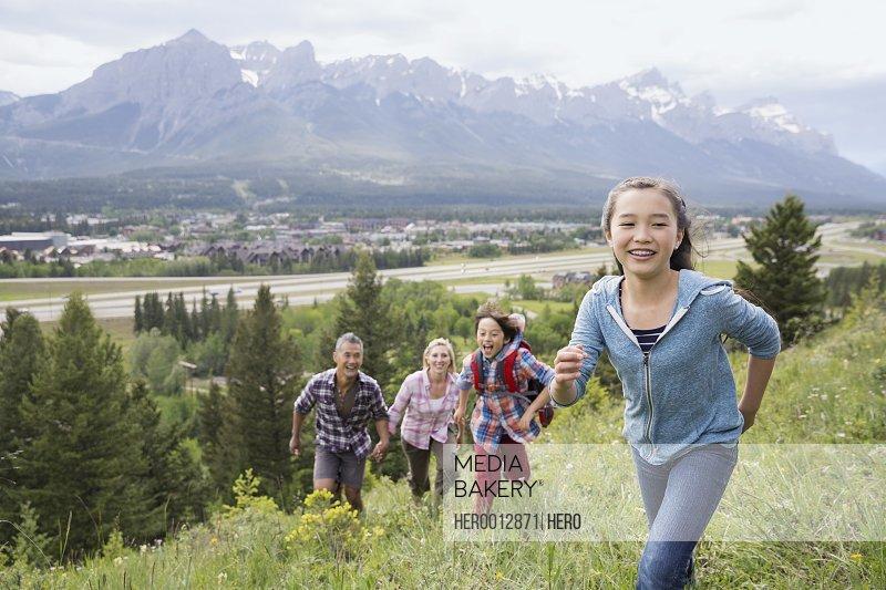 Family playing on rural hillside