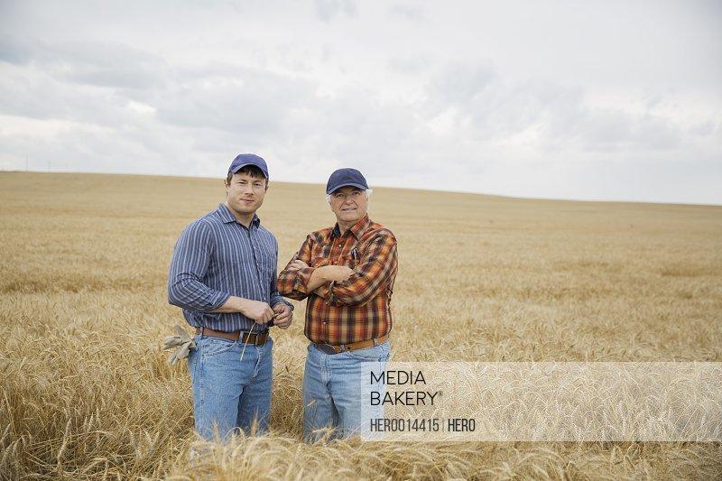 Portrait of farmers in wheat field