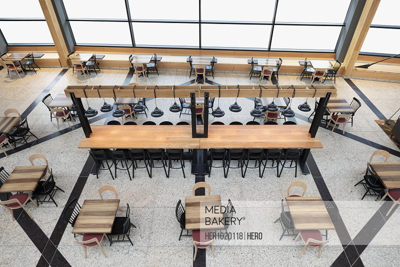 Tables and counter in empty atrium restaurant